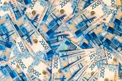 Russian money banknotes background. Lots of two thousandth bills. Paper rubles royalty free stock photo