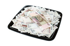 Russian money and black tray. Russian money on the black ceramic tray isolated on white background Stock Image