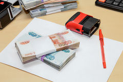Russian money, clean sheet of paper, pen, print on desk Stock Photo