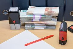 Russian money, clean sheet of paper, pen, print on table Stock Photos