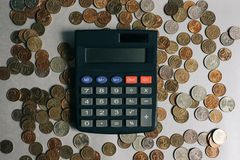 Russian money, coins and banknotes, calculator on the gray background royalty free stock photos
