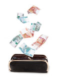 Russian money falling into the purse Stock Photos