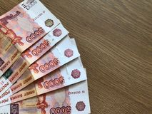 Russian money. Five thousands rubles on white background. Five thousand rubles paper bills on a light background royalty free stock photos