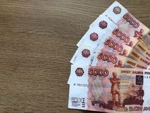 Russian money. Five thousands rubles on white background. Five thousand rubles paper bills on a light background royalty free stock photography