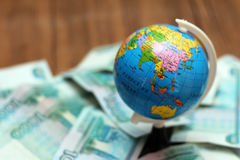 Russian money and the globe Royalty Free Stock Photos