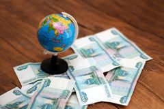 Russian money and the globe Royalty Free Stock Photo