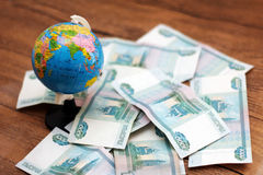 Russian money and the globe Royalty Free Stock Images
