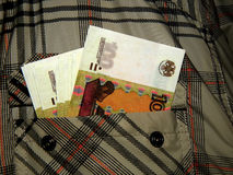 Russian money in his jacket pocket Stock Image