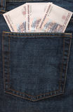 Russian money in jeans pocket. Three russian banknotes in back pocket of jeans Stock Photo