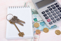 Russian money, key and calculator. real estate concept Stock Photo