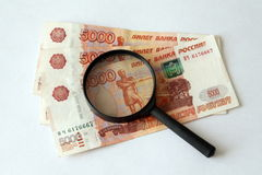 Russian money and magnifying glass Stock Photo