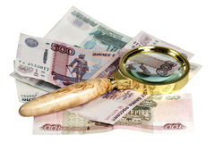 The Russian money and magnifying glass on a white background Royalty Free Stock Images