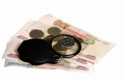 The Russian money and magnifying glass on a white background Royalty Free Stock Photography