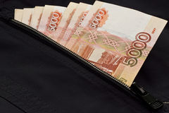 Russian money in the pocket of the jacket Stock Images