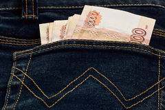 Russian money in the pocket of jeans Stock Photos