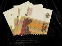 Russian money in the pocket of leather jacket Stock Photos