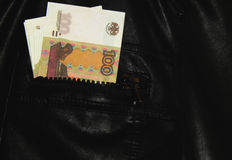 Russian money in the pocket of leather jacket Stock Photography