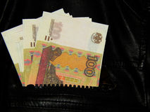 Russian money in the pocket of leather jacket Stock Image