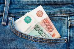 Russian money in the pocket. Rubles in the jeans pocket Royalty Free Stock Images
