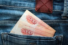 Russian money roubles in blue jeans pocket as a top view image stock photography