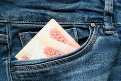 Russian money roubles in blue jeans pocket as a top view image royalty free stock image