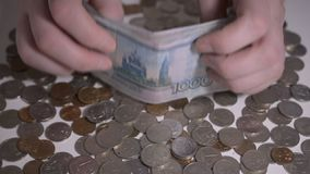 Russian money rubbles and coins over white table Hands count money slow motion hd footage abstract. For you ideas stock video footage