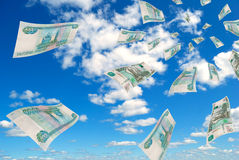 Russian money - rubles in the sky flying. Royalty Free Stock Photo