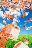 Russian money - rubles in the sky flying. Stock Photo