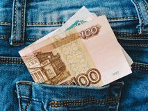 Russian money stick out of the back pocket of jeans.finance and currency concept. Top View. Russian money  in a jeans pocket, closeup.Russian money  stick out stock images