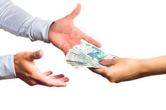 Russian money transfer from hand to hand. Russian money transfer from hand to hand on a white background Royalty Free Stock Image