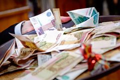 Russian money of various denominations lie on the table mixed. royalty free stock photography