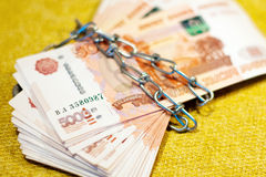 Russian money wrapped in a chain crisis Stock Images