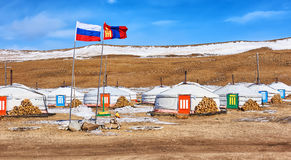 Russian and Mongolian flag next to gers (yurts). Russian and Mongolian flag next to yurts . Mongolia stock image