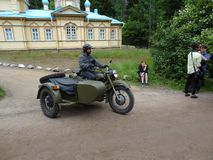 Russian motorcycle with side-car. Motorcycle in army green color in Russia royalty free stock photos