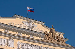 Russian Museum of Ethnography. The bas-relief of the Russian Museum of Ethnography and the flag on the roof Royalty Free Stock Photography