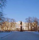 Russian museum and monument to Pushkin in St. Petersburg in the winter. In St. Petersburg in winter square in front of the Russian Museum is covered with snow Stock Photo