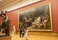 Russian Museum, the youth near painting Bruni royalty free stock images