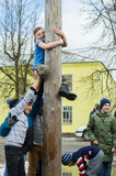 Russian national competition by climbing a wooden pole in celebration of the end of winter in the Kaluga region on March 13, 2016. Royalty Free Stock Photography