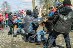Russian national competition in tug of war at the festival of farewell to winter in the Kaluga region on March 13, 2016. Royalty Free Stock Photography