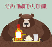 Russian national cuisine. Bear with a tray of traditional meal: Stock Images