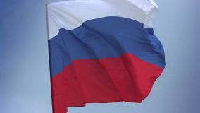 Russian national flag waving on flagpole in blue sky. Russia. Stock footage stock video footage