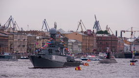 Russian Naval Parade. Warship and a submarine moored in the center of the city for all to see. On holiday masts waved flags stock video footage