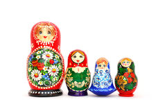 Russian Nesting Dolls. Four different russian nesting dolls standing in a row. Isolated on white Stock Images
