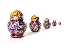 Russian Nesting Dolls. Lined up on white background, foreground focus stock images