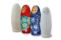 Russian nesting dolls. Painted and unpainted. Isolated on white stock photo