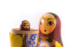 Russian nesting dolls. Small babushka doll peeping out from the bigger one Royalty Free Stock Photos