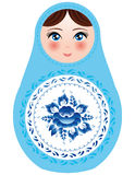 Russian nesting dolls on a white background with blue flowers.  Stock Photo