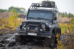 Russian off road car UAZ in mud Stock Photo