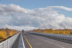 Russian off-road extreme expedition truck on the bridge, Kamchatka Peninsula, Russia. Unnamed Road, Kamchatka Peninsula, Russia- 02 October 2014: Russian off stock photo