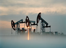 Russian oil production. Rigs on the oilfield Royalty Free Stock Photography